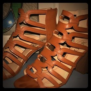 Brown strappy sandals with a heel and back zipper